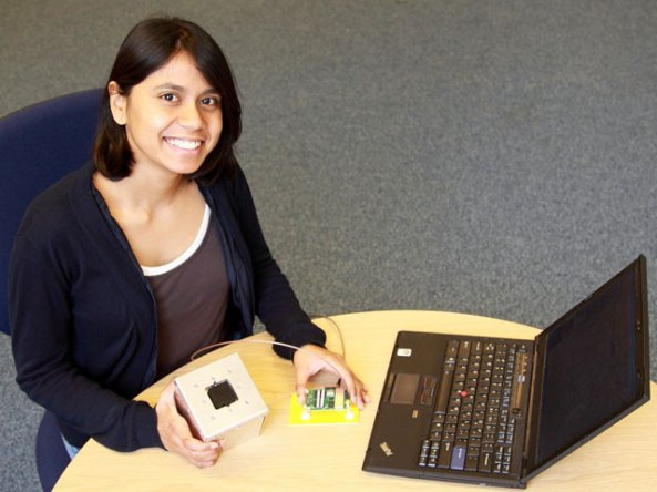 Talini holding a mockup of a cubesat (for testing antenna perfomance)