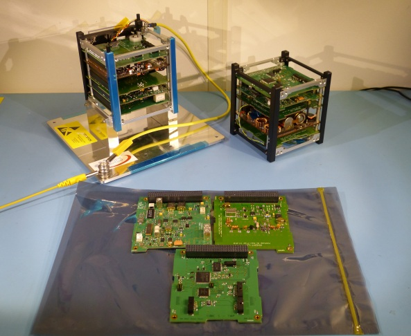 Flight and Engineering Models of FUNcube-1 with FUNcube-2 boards