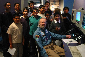 John Heath G7HIA with school pupils who took part in the International Space Station contact on April 4, 2003 from the UK National Space Centre