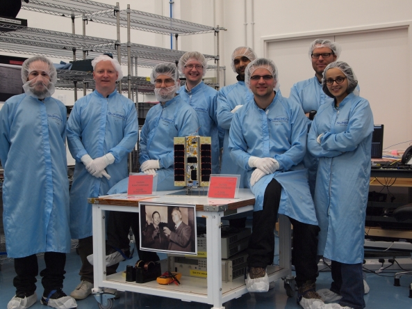 STRaND-1 and the team from left to right Ed Simons, Steve O'Donnell, Shaun Kenyon, Chris Bridges M6OBC / M0GKK, Nimal Navarathinam VE3NML, Pete Shaw, Ed Stevens, Susan Jason - Image credit Surrey Space Centre (SSC)