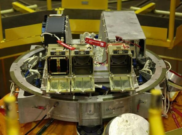 CubeSat deployment pods on top of the Bion-M1 spacecraft BeeSat-2, BeeSat-3 and SOMP are in the three 1U Launchers in the front OSSI-1 is a 1U and alone in a 3U-Pod behind left DOVE-2 is a 3U Cubesat and fills the 3U-Pod behind right