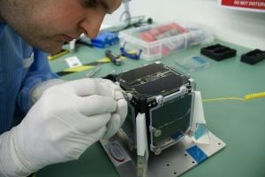Final gluing of FUNcube-1 bolt by Wouter Weggelaar PA3WEG – Image credit Gerard Aalbers
