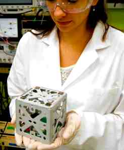 MIT student with a CubeSat - Image credit MIT