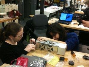 Students build a 3U CubeSat - Image Credit NASA