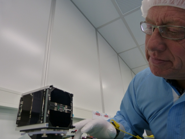 FUNcube-1 spacecraft in the clean room with Graham Shirville G3VZV