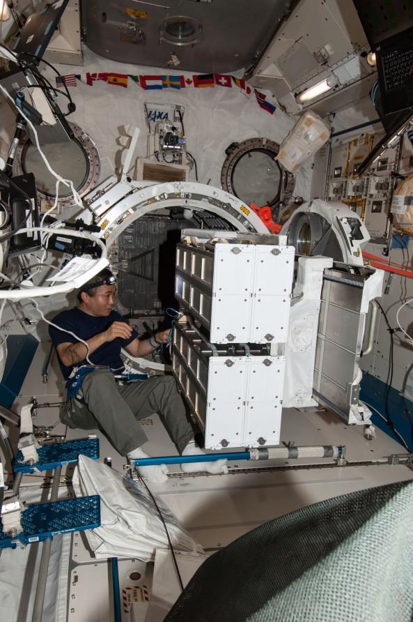 Astronaut Koichi Wakata KC5ZTA prepares NanoRacks CubeSat Deployers