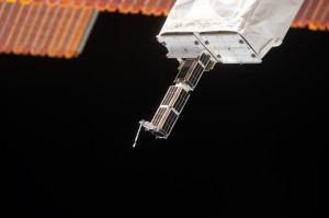 Planet Labs Dove CubeSats emerging from NanoRacks deployer February 11, 2014