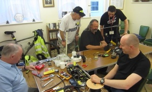 Peter M0PXD and Christopher G0IPU running the construction and soldering workshop