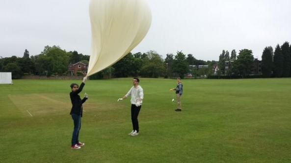 Damini, Matt and Isaac prepare to launch Armstrong in windy conditions