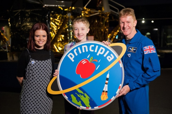 Blue Peter presenter Lindsey, competition winner Troy and UK astronaut Tim Peake KG5BVI with mission patch
