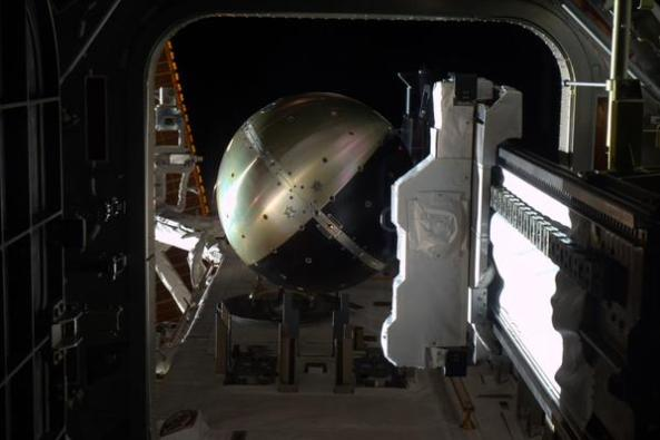 SpinSat extended from airlock