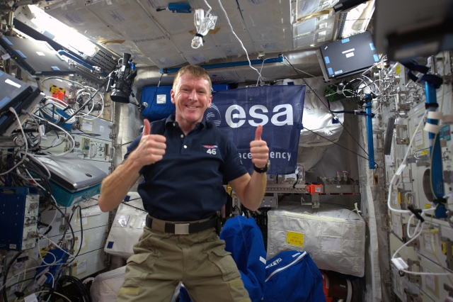 Astronaut Tim Peake KG5BVI / GB1SS giving the thumbs up shortly after his arrival on the ISS