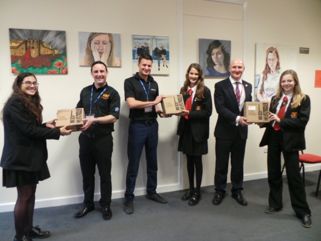 Handheld transceivers being presented to Sandringham School students