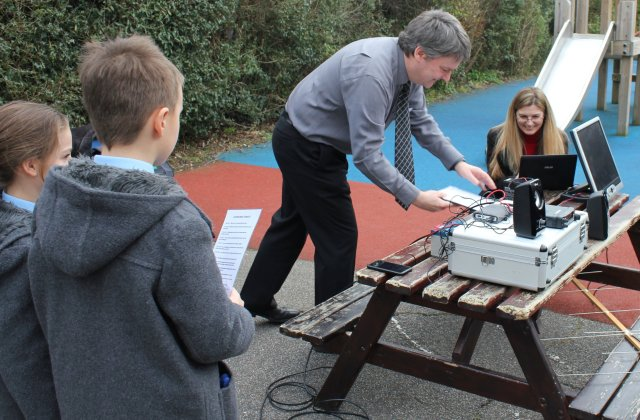 Pete M0PSX and Sarah M6PSK set up the equipment at St Michael's School