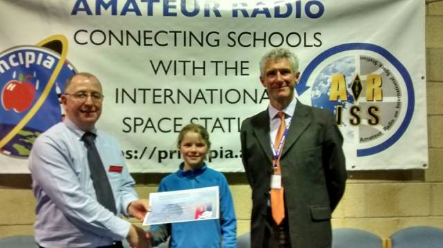 Ten-year-old Lauren, M6HLR was presented with her Gold Award by RSGB DRM Keith Bird, G4JED and Wellesley House Head, Simon O'Malley - Credit RSGB