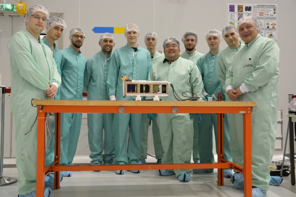 The entire Fly Your Satellite 2016 delegation with CubeSats in P-Pod