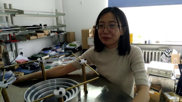 Hu Chaoran BG2CRY tests 435/2250 MHz dish feed for DSLWP ground station - Image credit Wei Mingchuan BG2BHC
