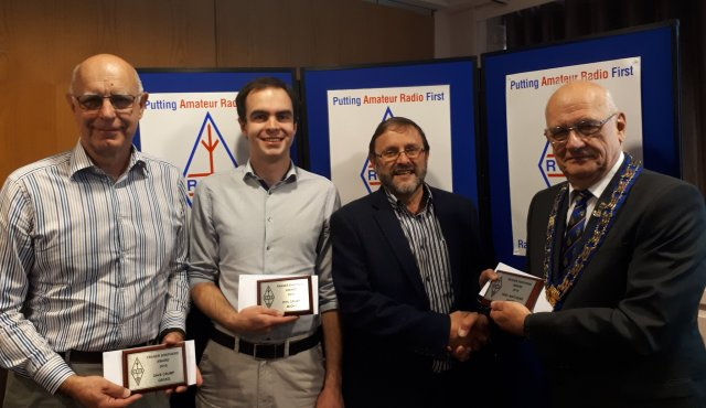 Dave Crump G8GKQ, Phil Crump M0DNY and Noel Matthews G8GTZ receive award from RSGB President Dave Wilson M0OBW - image credit RSGB